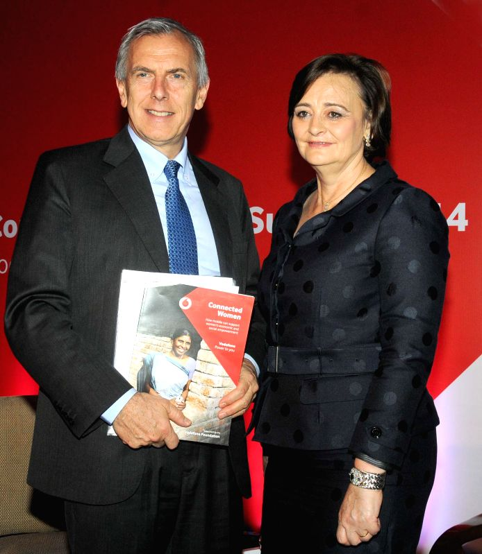 Vodafone CEO and Managing Director, Marten Pieters (L) and founder of the Cherie Blair Foundation for Women, Cherie Blair release the `Vodafone Connected Women Report 2014`  during a press conference