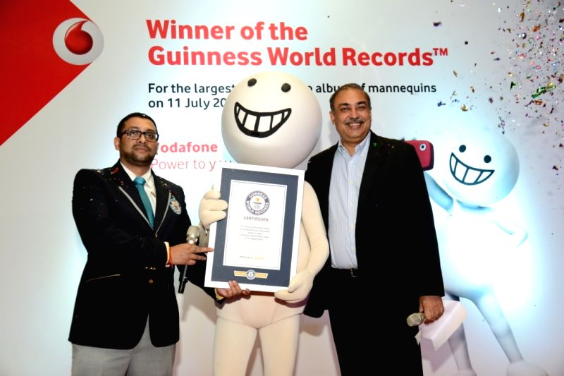 Vodafone India Managing Director and CEO Sunil Sood with Guinness World Records  India Adjugator Rishi Nath after  Vodafone India created a Guinness World Records for the 'largest online ... - Adjugator Rishi Nath