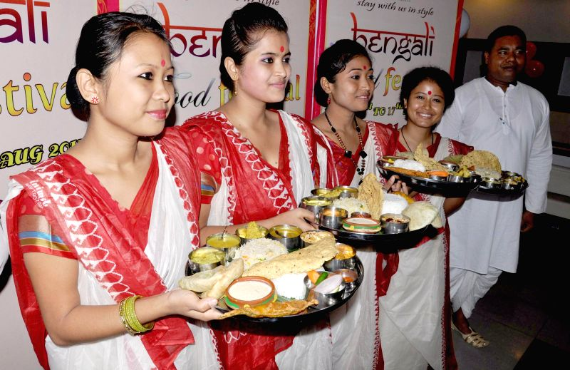 Volunteers during inauguration of 17-days long Bengali Food Festival in Guwahati on August 1, 2014.