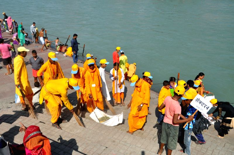 Volunteers of World Gayatri Pariwar along with busy cleaning banks of river Ganga as a part of Virat Swachta Abhiyan in Haridwar on May 2, 2017.