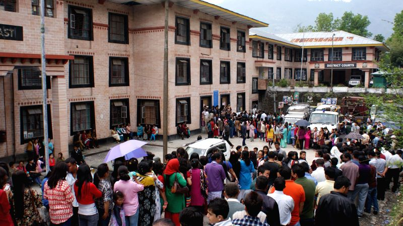 Voters que for casting vote at the Upper Butruk polling station in East Sikkim on April 12, 2014.