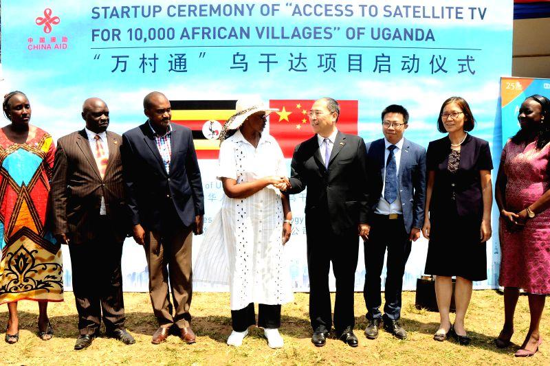 WAKISO, July 21, 2018 - Janet Museveni (4th L), Ugandan minister of education and sports, and Zheng Zhuqiang (4th R), Chinese ambassador to Uganda, attend the launching ceremony in Kakiri SOS ...