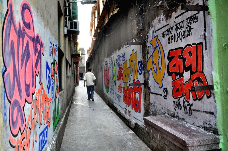 Walls painted with political graffiti ahead of 2014 Lok Sabha Elections, scheduled to be held on 12th May 2014; in Kolkata on April 24, 2014.