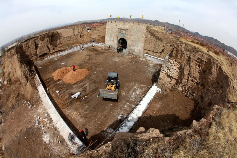Workers restore the southern barbican entrance to Wanquan Castle in Wanquan County, north China's Hebei Province, April 6, 2015. Wanquan Castle, which was built in ...