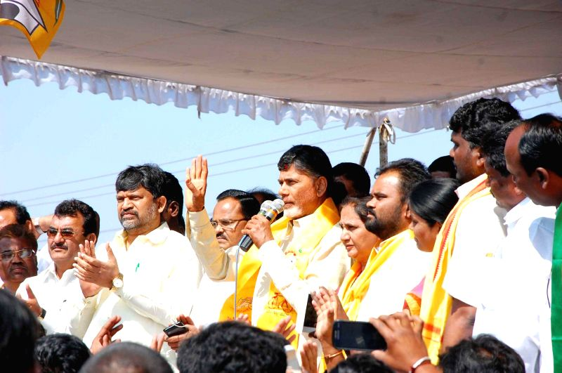 Andhra Pradesh Chief Minister N. Chandrababu Naidu addresses a rally during his visit to Warangal in Telangana on Feb 12, 2015. - N. Chandrababu Naidu