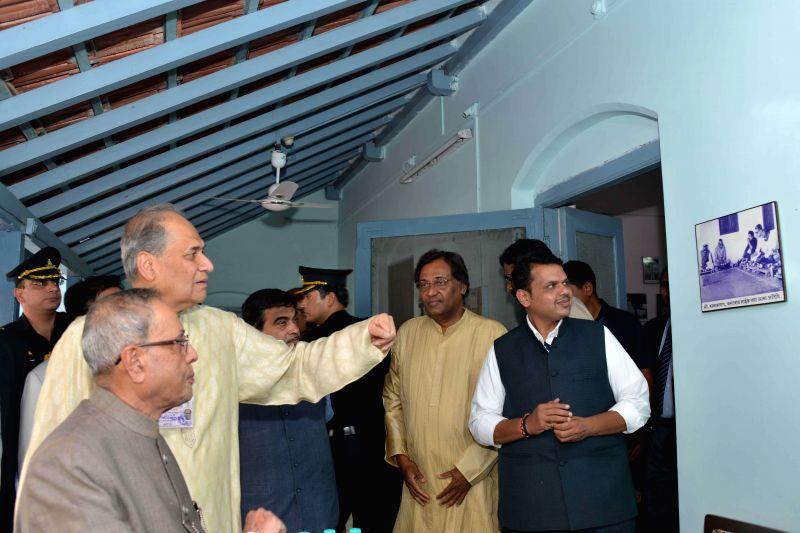 President Pranab Mukherjee visits Bajaj Science Centre in Wardha, Maharashtra on Nov 26, 2014. Also seen Maharashtra Chief Minister Devendra Fadnavis. - Devendra Fadnavis and Pranab Mukherjee
