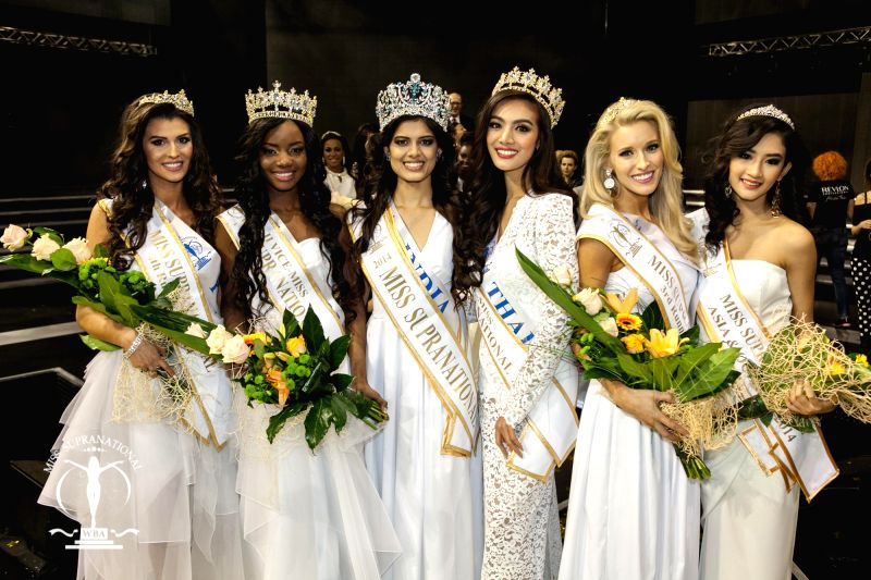 Asha Bhatt, who was crowned Miss Supranational 2014 with other contestants in Warsaw, Poland on Dec 6, 2014.