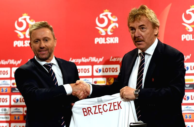 WARSAW, July 24, 2018 - Jerzy Brzeczek (L), new head coach of Polish national football team, shakes hand with Zbigniew Boniek, head of Polish Football Association, as he receives a Polish national ...