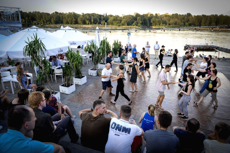 WARSAW, July 30, 2018 - People attend a West Coast Swing dancing lesson by the Vistula River in Warsaw, Poland, on July 30, 2018. West Coast Swing is a popular dance style which is increasingly ...