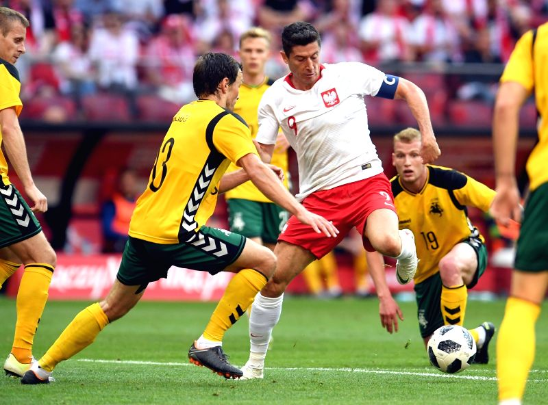 Warsaw, June 13, 2018 - Robert Lewandowski (C) of Poland competes during a friendly soccer match between Poland and Lithuania in Warsaw, Poland, on June 12, 2018. Poland won 4-0.
