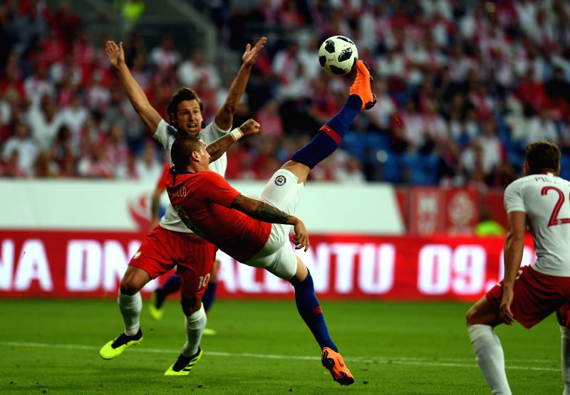 WARSAW, June 9, 2018 - Nicolas Castillo (2nd L) of Chile shoots during the international friendly game between Poland and Chile in Warsaw, Poland, on June 8, 2018.