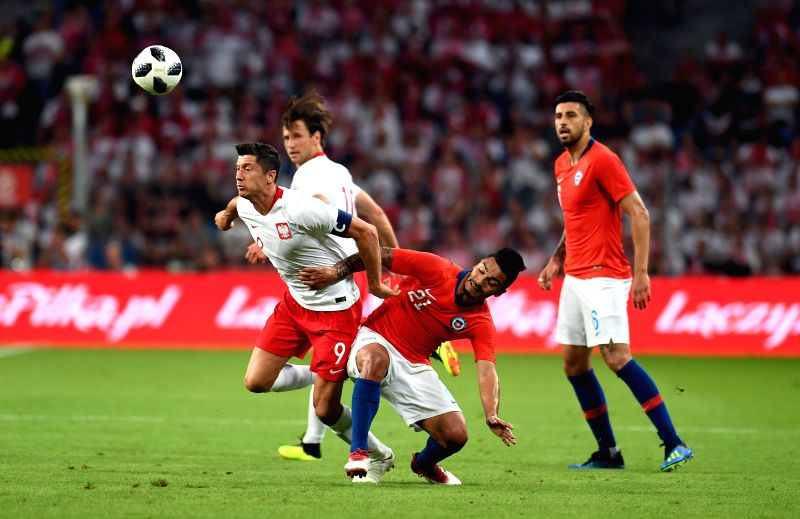 WARSAW, June 9, 2018 - Robert Lewandowski (1st L) of Poland vies with Lorenzo Reyes (2nd R) of Chile during the international friendly game between Poland and Chile in Warsaw, Poland, on June 8, 2018.