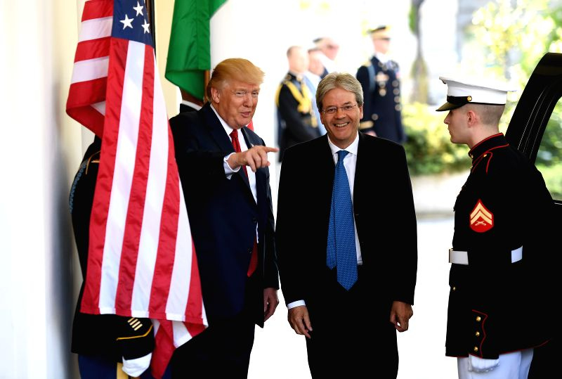 WASHINGTON, April 20, 2017 - U.S. President Donald Trump (1st L) welcomes Italian Prime Minister Paolo Gentiloni (2nd L) upon his arrival at the White House in Washington D.C., the United States, on ... - Paolo Gentiloni