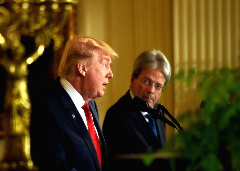 WASHINGTON, April 20, 2017 - U.S. President Donald Trump (L) and Italian Prime Minister Paolo Gentiloni are seen in a mirror during a joint press conference after their meeting at the White House in ... - Paolo Gentiloni