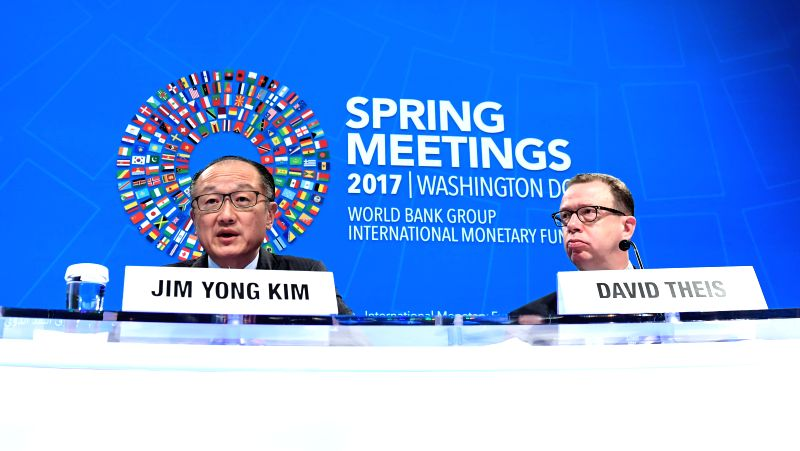 WASHINGTON, April 20, 2017 - World Bank President Jim Yong Kim (L) speaks at the opening press conference of the 2017 World Bank and International Monetary Fund (IMF) Spring Meetings in Washington ...