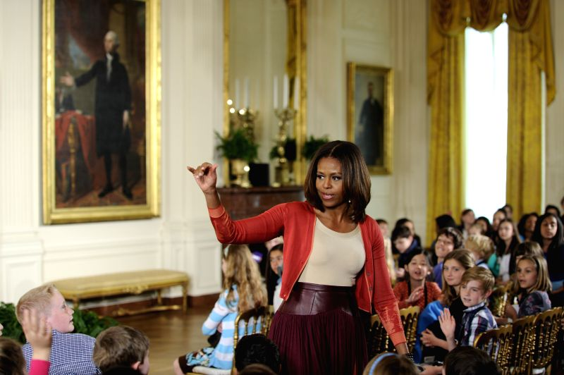 U.S. first lady Michelle Obama greets with children of Executive Office employees at the White House's annual Take Our Daughters and Sons to Work Day in the ...