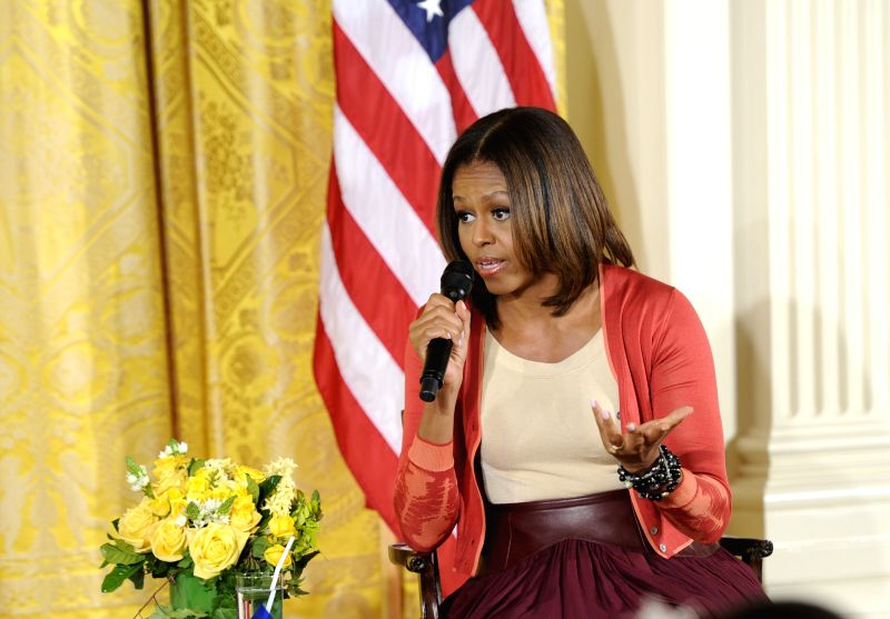 U.S. first lady Michelle Obama speaks with children of Executive Office employees at the White House's annual Take Our Daughters and Sons to Work Day in the ...