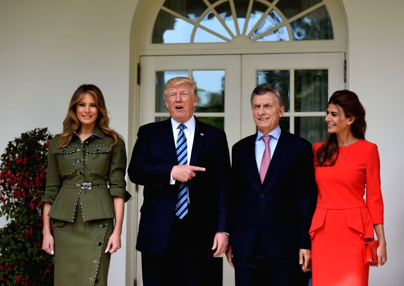 WASHINGTON, April 27, 2017 - U.S. President Donald Trump (2nd L) and First Lady Melania Trump (1st L) welcome President of Argentina Mauricio Macri (2nd R) and the First Lady of Argentina Juliana ...