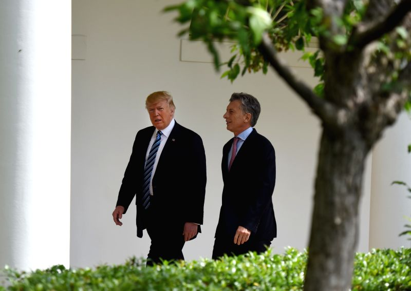 WASHINGTON, April 27, 2017 - U.S. President Donald Trump (L) and President of Argentina Mauricio Macri walk through the Colonnade of the White House in Washington D.C., the United States, April 27, ...