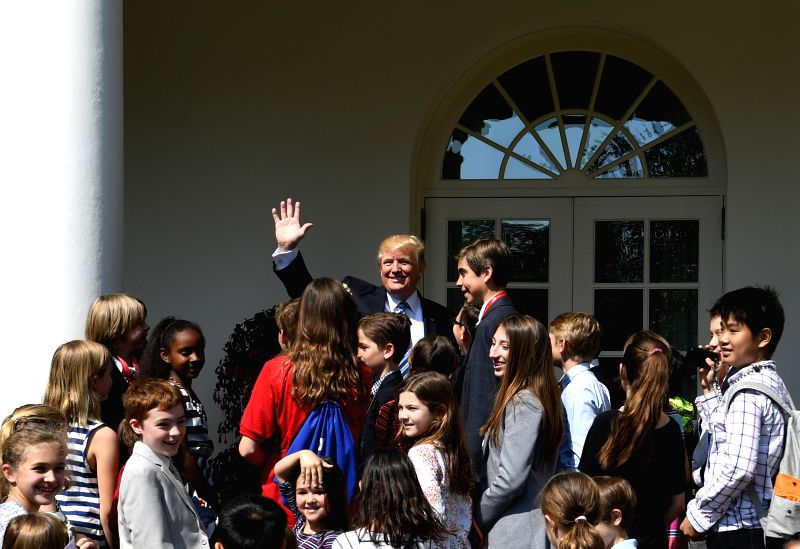 "WASHINGTON, April 27, 2017 - U.S. President Donald Trump (C) greets children of White House staffers and reporters during ""Take Our Daughters and Sons to Work Day"" at the White House in ..."