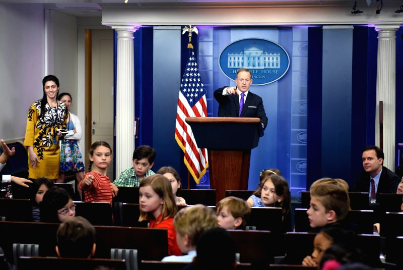 "WASHINGTON, April 27, 2017 - White House spokesman Sean Spicer (C) answers questions from the children of White House staffers and reporters at a mock briefing during ""Take Our Daughters and ..."