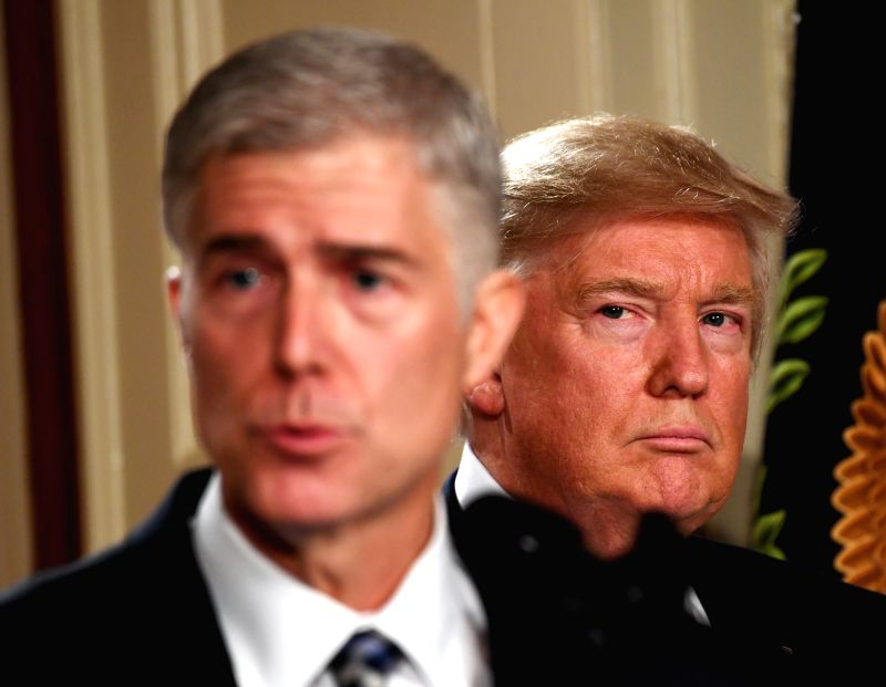 WASHINGTON, April 29, 2017 - File photo taken on Jan. 31, 2017 shows Judge Neil Gorsuch (L) speaking after U.S. President Donald Trump nominated him as the new justice for the Supreme Court at the ...