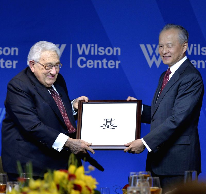 Chinese ambassador to the United States Cui Tiankai (R) and former US Secretary of State Henry Kissinger pose for a photo during an unveiling ceremony of the ...