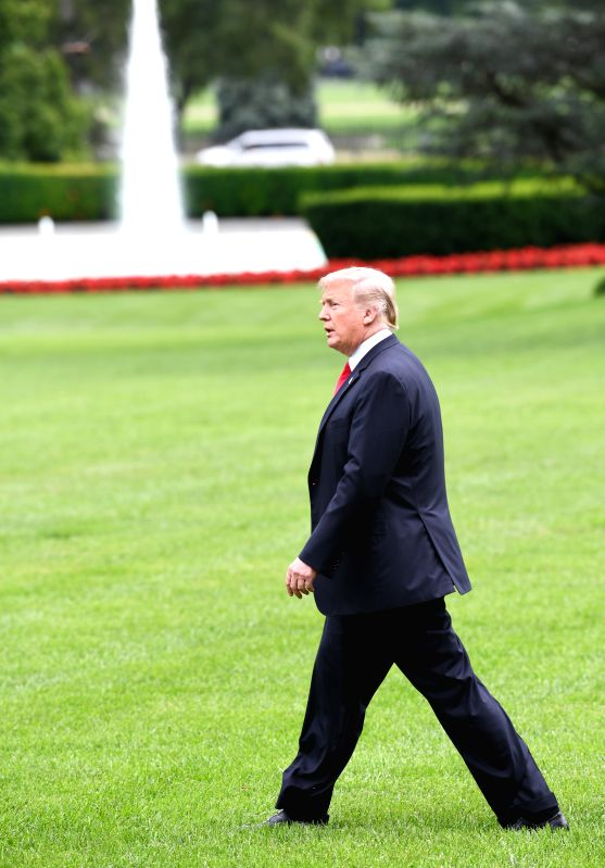 WASHINGTON, Aug. 1, 2018 - U.S. President Donald Trump walks on the South Lawn heading for the Marine One in Washington D.C., the United States, on July 31, 2018. U.S. President Donald Trump said on ...