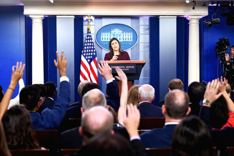 WASHINGTON, Aug. 14, 2018 (Xinhua) -- White House spokesperson Sarah Sanders attends a press briefing at the White House in Washington D.C., the United States, Aug. 14, 2018. The White House said Tuesday that U.S. National Security Advisor John Bolto