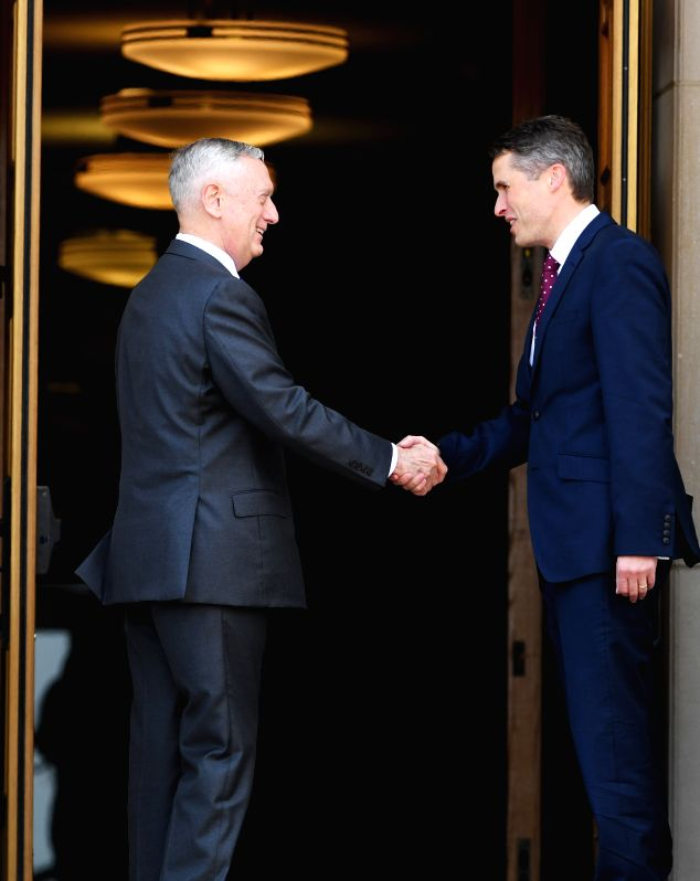 WASHINGTON, Aug. 7, 2018 - U.S. Defense Secretary James Mattis (L) shakes hands with British Defense Secretary Gavin Williamson at the Pentagon, Virginia, the United States, on Aug. 7, 2018.