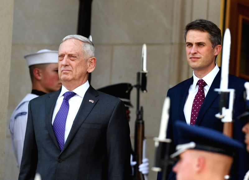 WASHINGTON, Aug. 7, 2018 - U.S. Defense Secretary James Mattis (2nd L) welcomes British Defense Secretary Gavin Williamson at the Pentagon, Virginia, the United States, on Aug. 7, 2018.