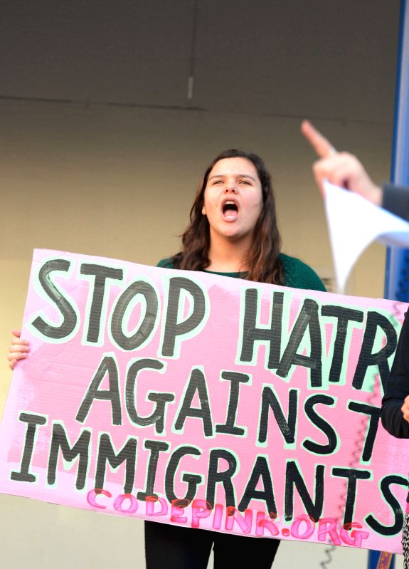 Washington D.C. : A member of the anti-war group Code Pink protests against U.S. Republican presidential candidate Donald Trump's racism words before the Trump Hotel in Washington D.C., the United ...