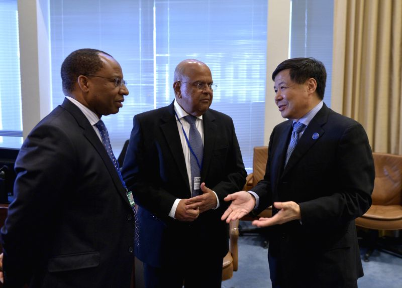 Chinese Vice Finance Minister Zhu Guangyao (R) talks with South African Finance Minister Pravin Gordhan (C) before the Finance Ministers and Central Bank .. - Zhu Guangyao