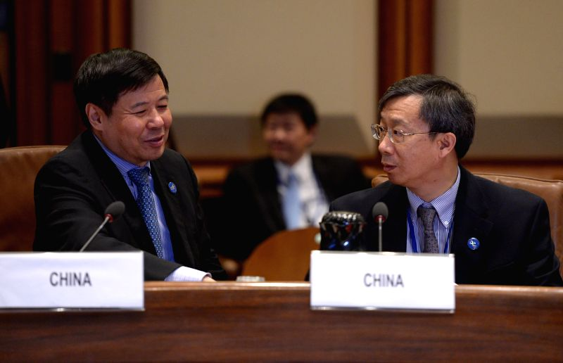 Chinese Vice Finance Minister Zhu Guangyao (L) and Deputy Central Bank Governor Yi Gang attend the Finance Ministers and Central Bank Governors Meeting of . - Zhu Guangyao