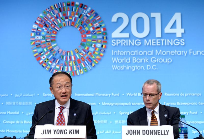 World Bank President Jim Yong Kim (L) speaks at a press conference before the IMF and World Bank spring meetings to release a report at the IMF ...