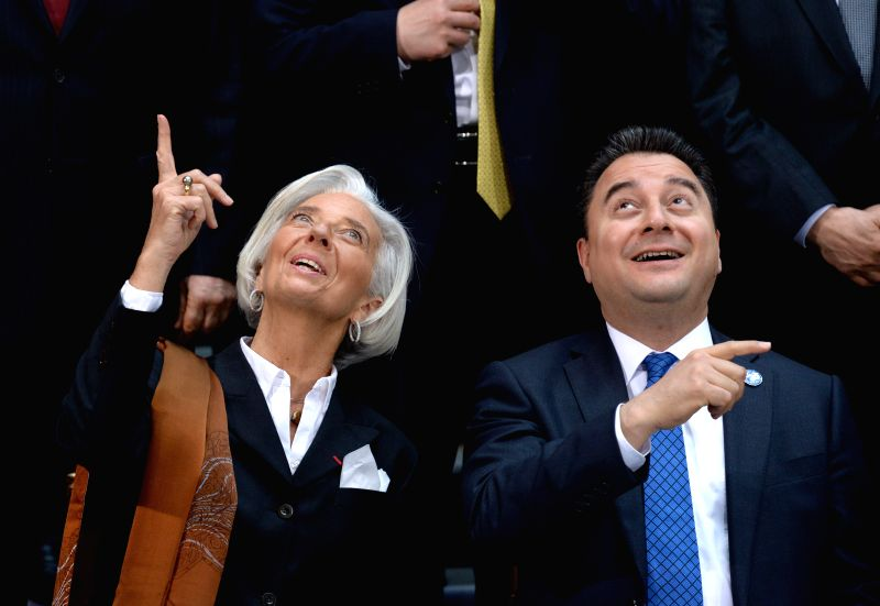 International Monetary Fund (IMF) Managing Director Christine Lagarde (L) and Turkish Deputy Prime Minister Ali Babacan (R) wait for a family photo of ... - Ali Babacan