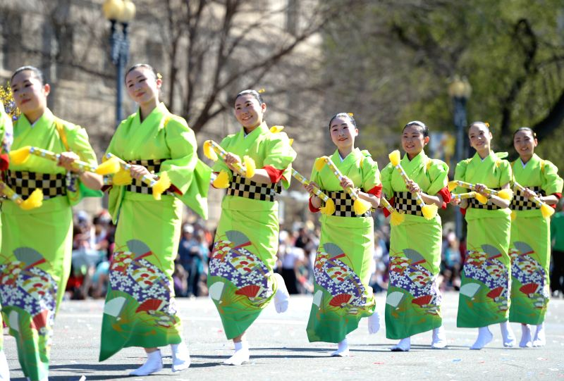 People perform during the annual Cherry Blossom Festival Parade along the Constitution Avenue in Washington D.C., capital of the United States, April 12, ..