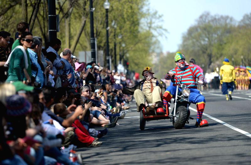Two clowns perform during the annual Cherry Blossom Festival Parade along the Constitution Avenue in Washington D.C., capital of the United States, April ..