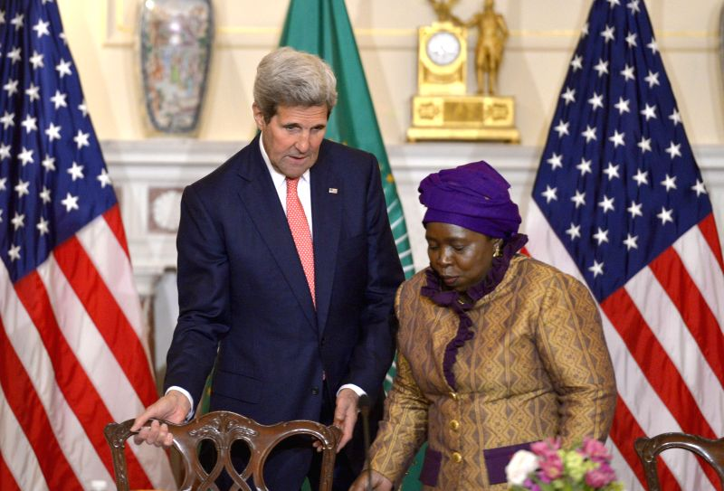 U.S. Secretary of State John Kerry (R) and African Union Commission Chairperson Nkosazana Dlamini Zuma arrive for the signing of a memorandum of ...