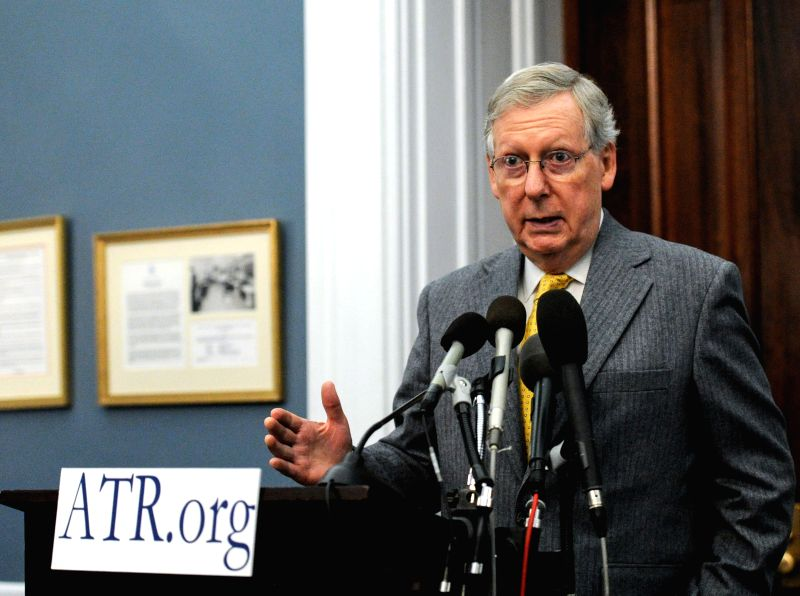 """U.S. Senate Majority Leader Mitch McConnell speaks during the Americans for Tax Reform's annual """"Tax Day Eve"""" press conference on Capitol Hill in ..."""