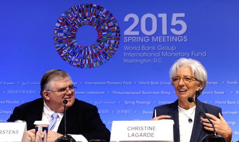 International Monetary Fund (IMF) Managing Director Christine Lagarde(R) speaks at a press conference during IMF-World Bank 2015 Spring Meeting in ...