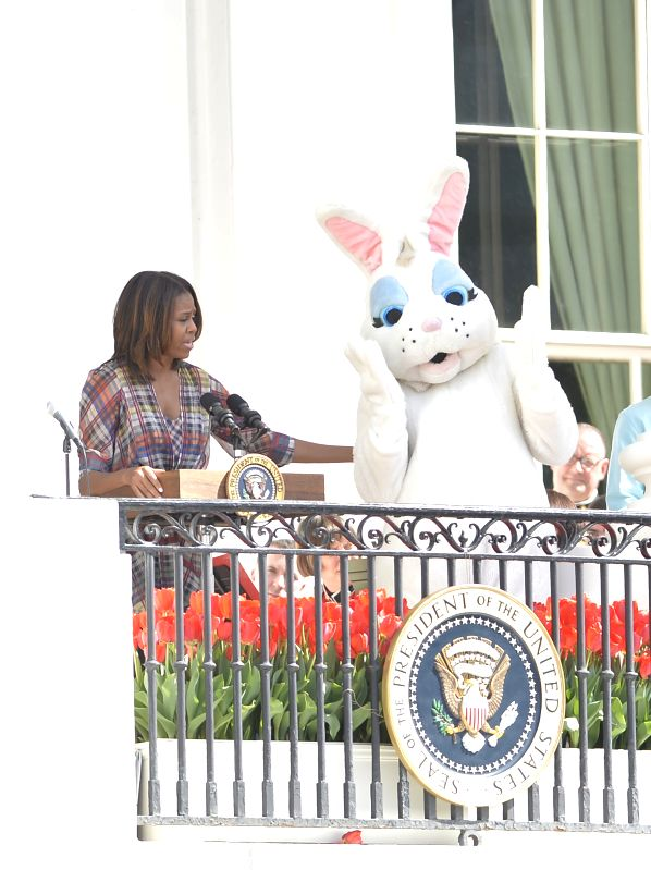 U.S. First Lady Michelle Obama speaks before an egg roll race during the White House Easter Egg Roll on the South Lawn of the White House in Washington ...