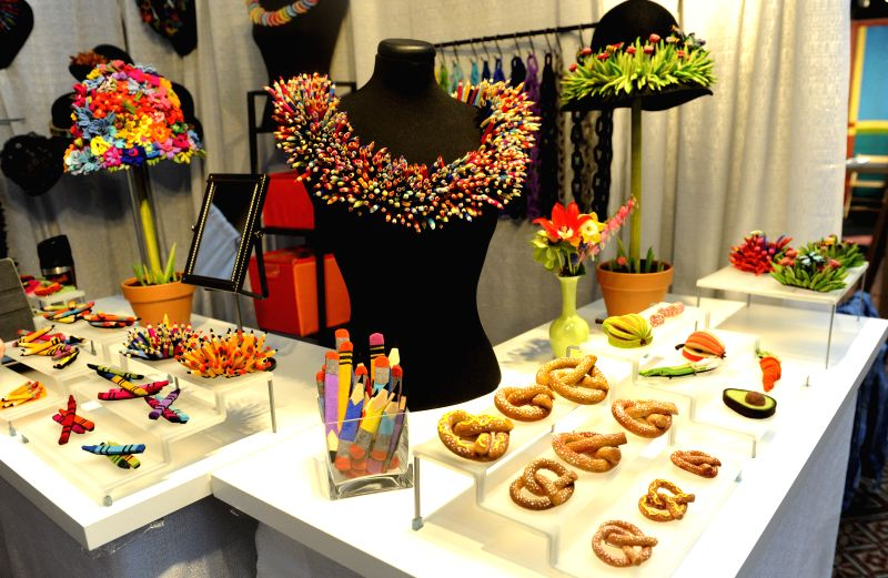 Exhibits are displayed at the preview of Smithsonian Craft Show in Washington D.C., capital of the United States, April 22, 2015. 2015 Smithsonian Craft ...