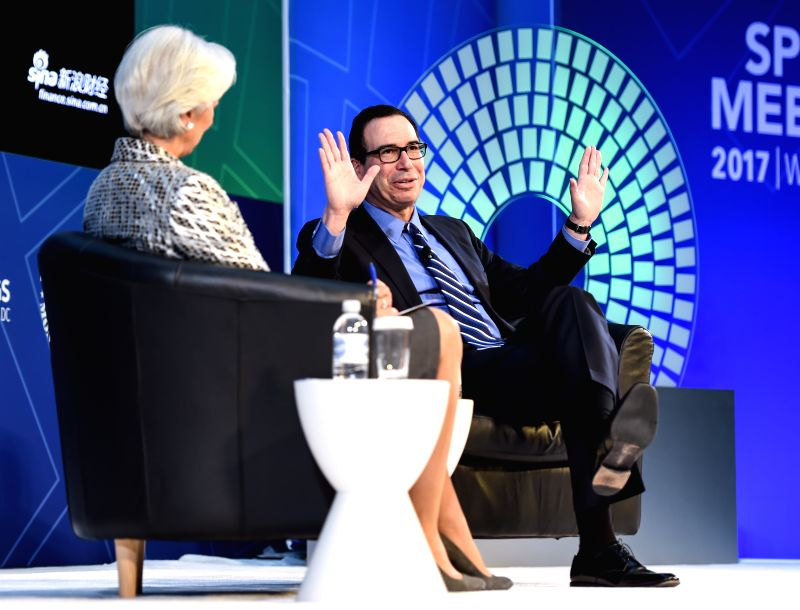 WASHINGTON D.C., April 23, 2017 - U.S. Treasury Secretary Steven Mnuchin (R) speaks with Christine Lagarde, managing director of the International Monetary Fund (IMF), during a conversation on the ...