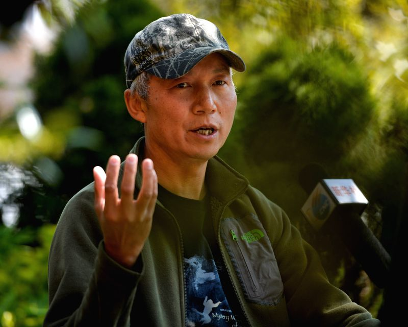 China's wildlife photographer Xi Zhinong speaks at an interview with Xinhua in Washington D.C., capital of the United States, April 24, 2015. The new ...