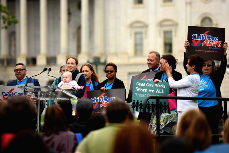 WASHINGTON D.C., April 25, 2017 - People attend a rally raising awareness of the need for excellent and affordable child care accessible for all families on Capitol Hill in Washington D.C., the ...