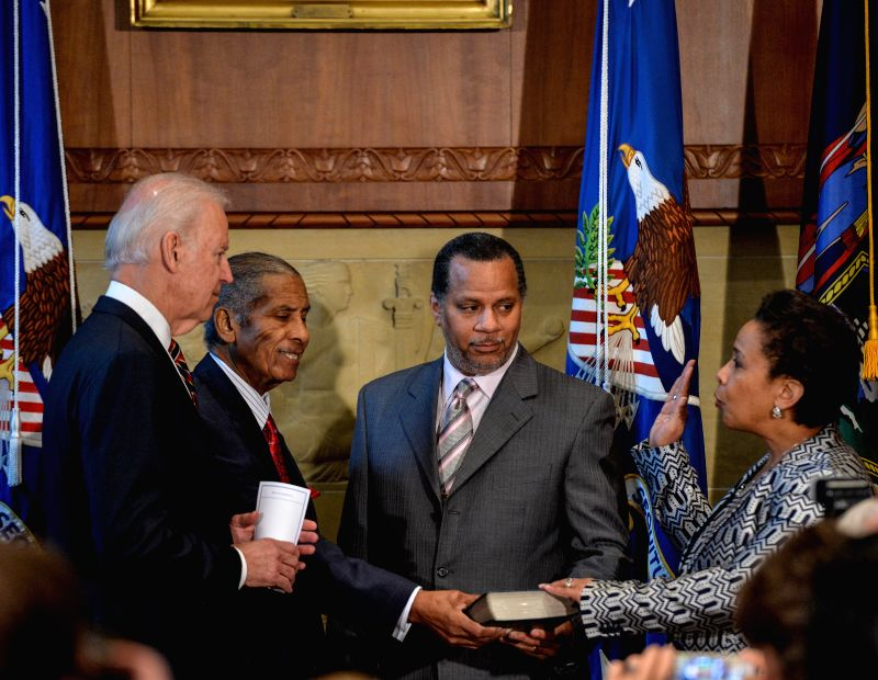 U.S. Vice President Joe Biden (1st L) swears in Loretta Lynch (1st R) as the 83rd U.S. Attorney General at the Department of Justice in Washington D.C., ...