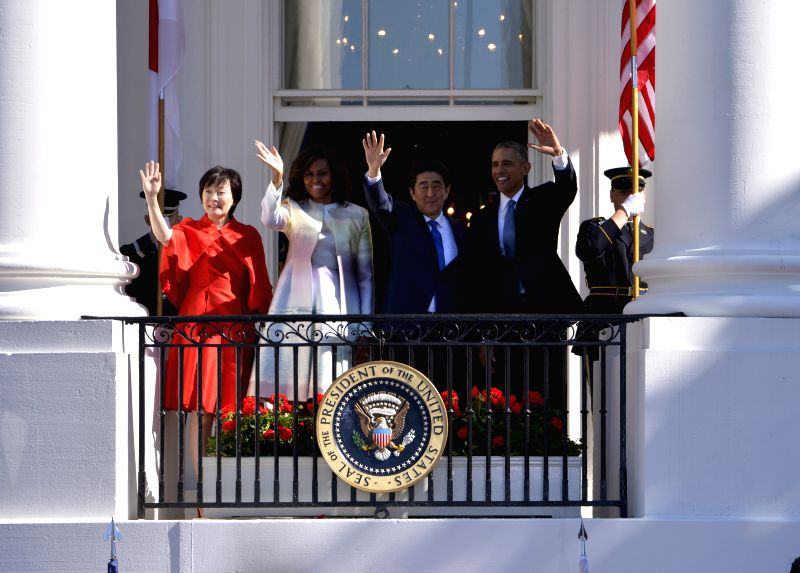 U.S. President Barack Obama (1st R) and visiting Japanese Prime Minister Shinzo Abe (2nd R) attend a welcoming ceremony on the South Lawn of the White ... - Shinzo Abe