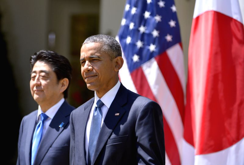 U.S. President Barack Obama (R) and visiting Japanese Prime Minister Shinzo Abe arrive for a joint news conference in the White House in Washington D.C., ... - Shinzo Abe