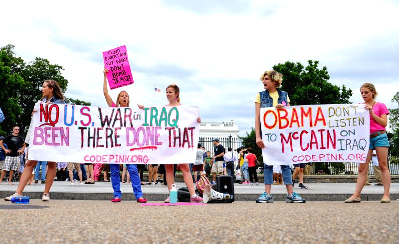 A rally to protest the U.S. airstrikes in Iraq is held outside the White House in Washington D.C., capital of the United States, Aug. 11, 2014.(Xinhua/Bao ..